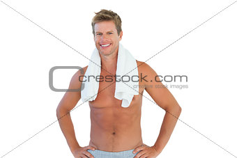 Shirtless man standing with hands on hips