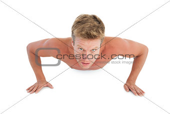 Shirtless man doing push ups