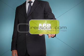 Businessman touching green tag with the word agb written on it