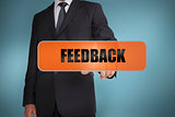 Businessman touching the word feedback