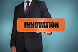 Businessman touching the word innovation