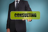 Businessman touching the word consulting written on green tag