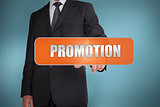 Businessman selecting the word promotion written on orange tag
