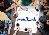Feedback written on a poster with drawings of charts