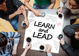 Learn and lead written on a poster with drawings of charts