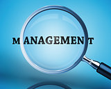 Magnifying glass showing management word