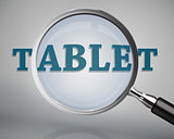 Magnifying glass showing tablet word