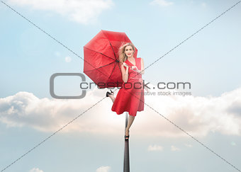 Attractive woman holding umbrella