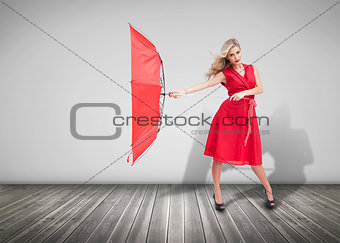 Pretty glamour woman holding a broken umbrella