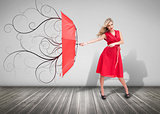 Beautiful woman holding a broken umbrella