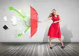 Woman wearing red dress and holding umbrella