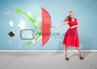 Attractive woman standing in an empty room