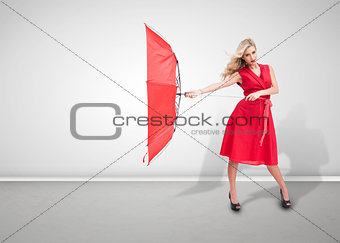 Beautiful woman wearing red dress and holding umbrella