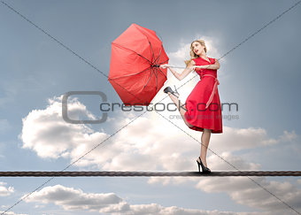 Beautiful woman standing on rope