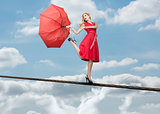 Pretty woman standing over the clouds