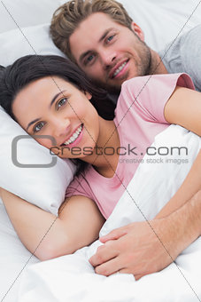 Portrait of a couple embracing in bed