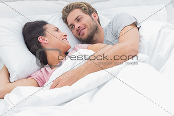 Couple embracing and looking at each other
