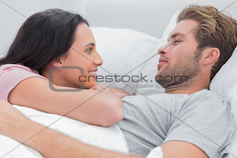 Couple awaking and looking at each other