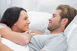 Cheerful couple awaking and looking at each other