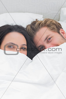 Beautiful couple under the duvet