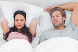 Woman annoyed by the snoring of her partner