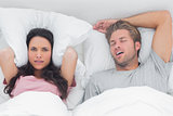 Woman annoyed by the snoring of her husband