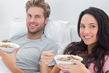 Couple eating cereal for breakfast