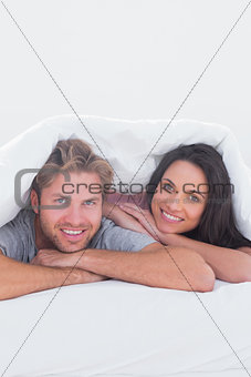 Beautiful couple under the cover