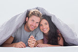 Beautiful couple under the quilt