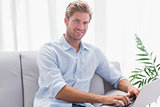 Man using his laptop sat on the couch