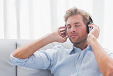 Man listening to music on a couch