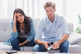 Couple looking anxious while doing their accounts