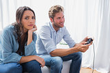 Upset woman annoyed that her partner is playing video games