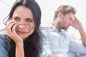 Annoyed woman holding her head