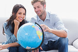 Couple looking at a globe