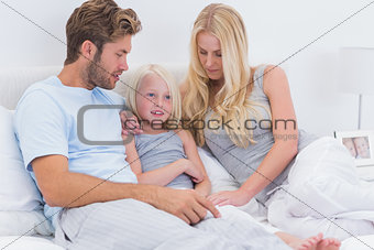 Couple chatting with their daughter