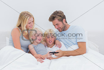 Beautiful family using a smartphone