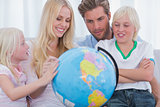 Smiling family with globe
