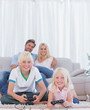 Children on the carpet playing video games