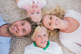 Overhead of family lying in a circle