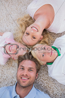 Family lying in a circle