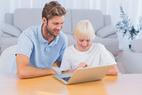 Father and his son using laptop