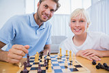 Father and his little boy playing chess