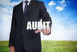 Businessman selecting audit word