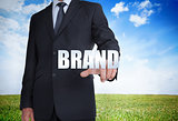 Businessman selecting brand word