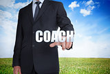 Businessman selecting coach word