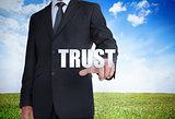 Businessman selecting trust word