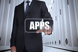 Businessman in a data center selecting label with apps