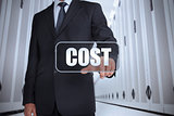 Businessman in a data center selecting label with cost