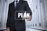 Businessman in a data center selecting label with plan